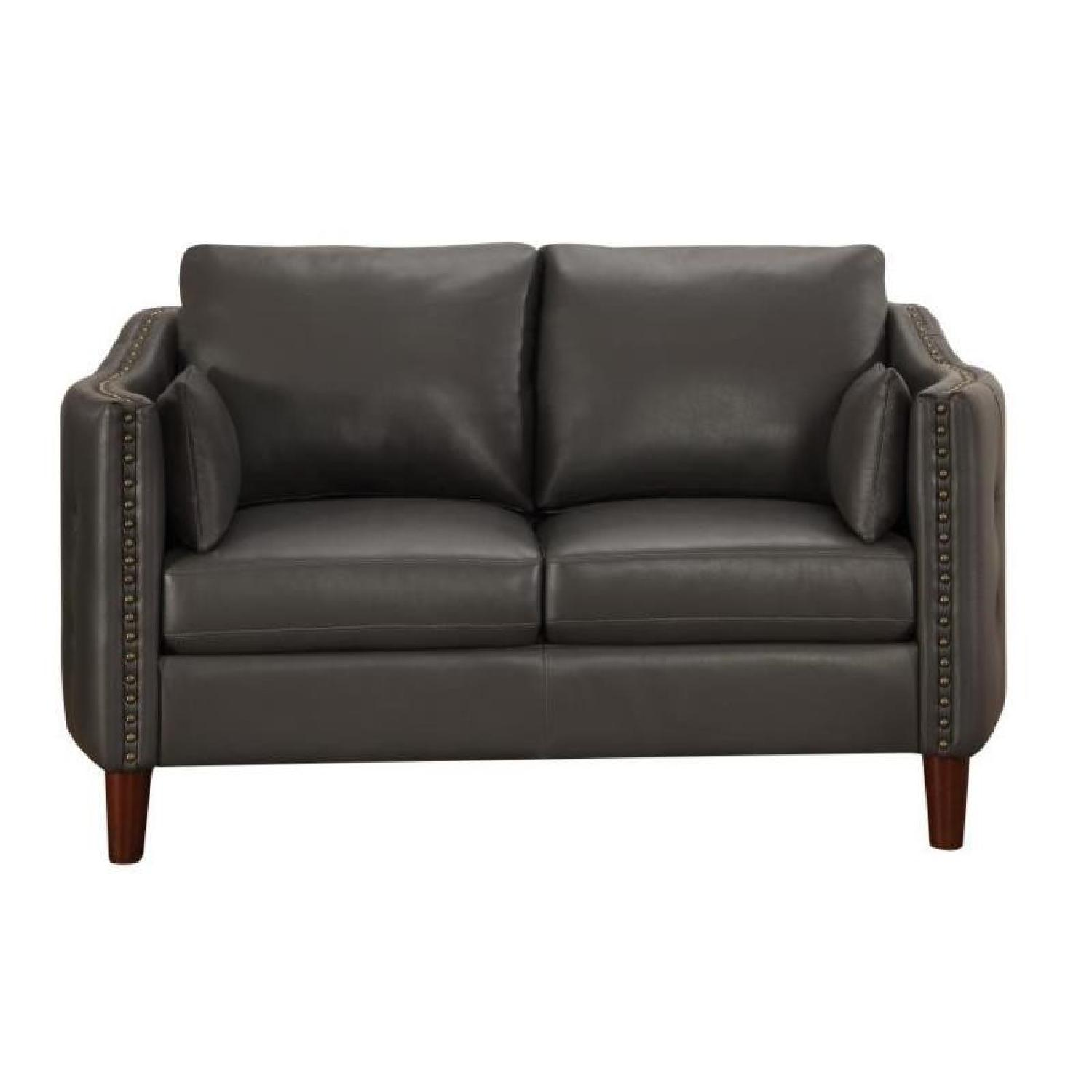 Loveseat in Dark Grey Leatherette w/ Nailhead Accent & Button Tufted Sides