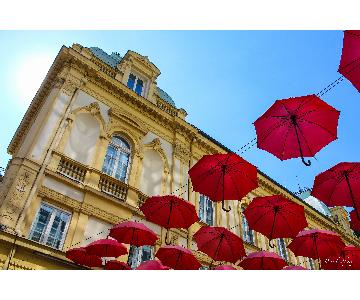 Daniel Odyssey LLC Floating Red Umbrellas From Europe