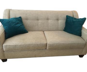 Bob's Cream Colored 2 Seater Sofa