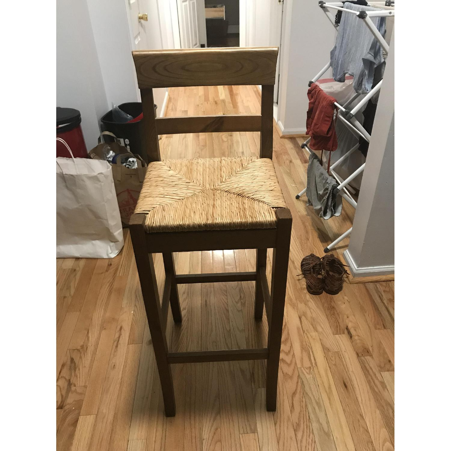 pier 1 brown wooden bar stool w woven seat0