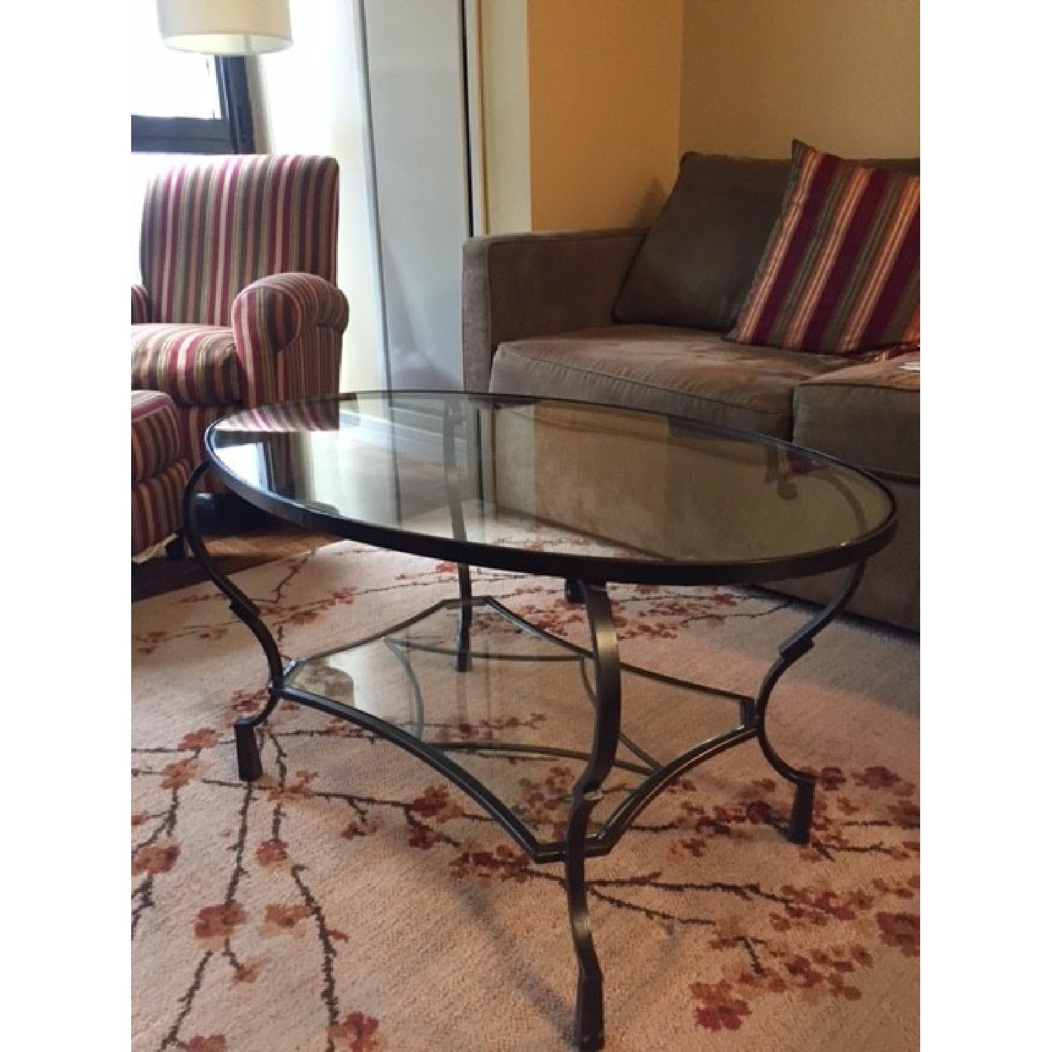 pier 1 chasca collection glass top oval coffee table - aptdeco