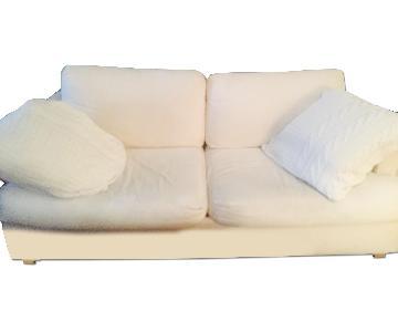 Off White Slipcovered Sofa