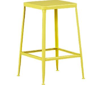 cb2 flint counter stool in yellow