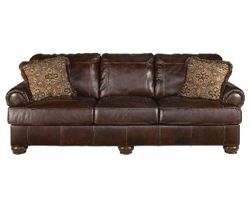 Ashley's Axiom Sleeper Sofa in Walnut