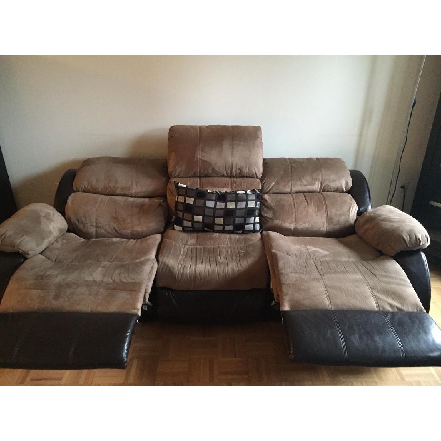 Ashley's Presley Dual Reclining Sofa in Cocoa - image-1