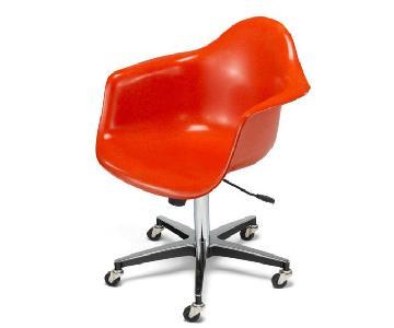 Modernica Fiberglass Shell Rolling Chair