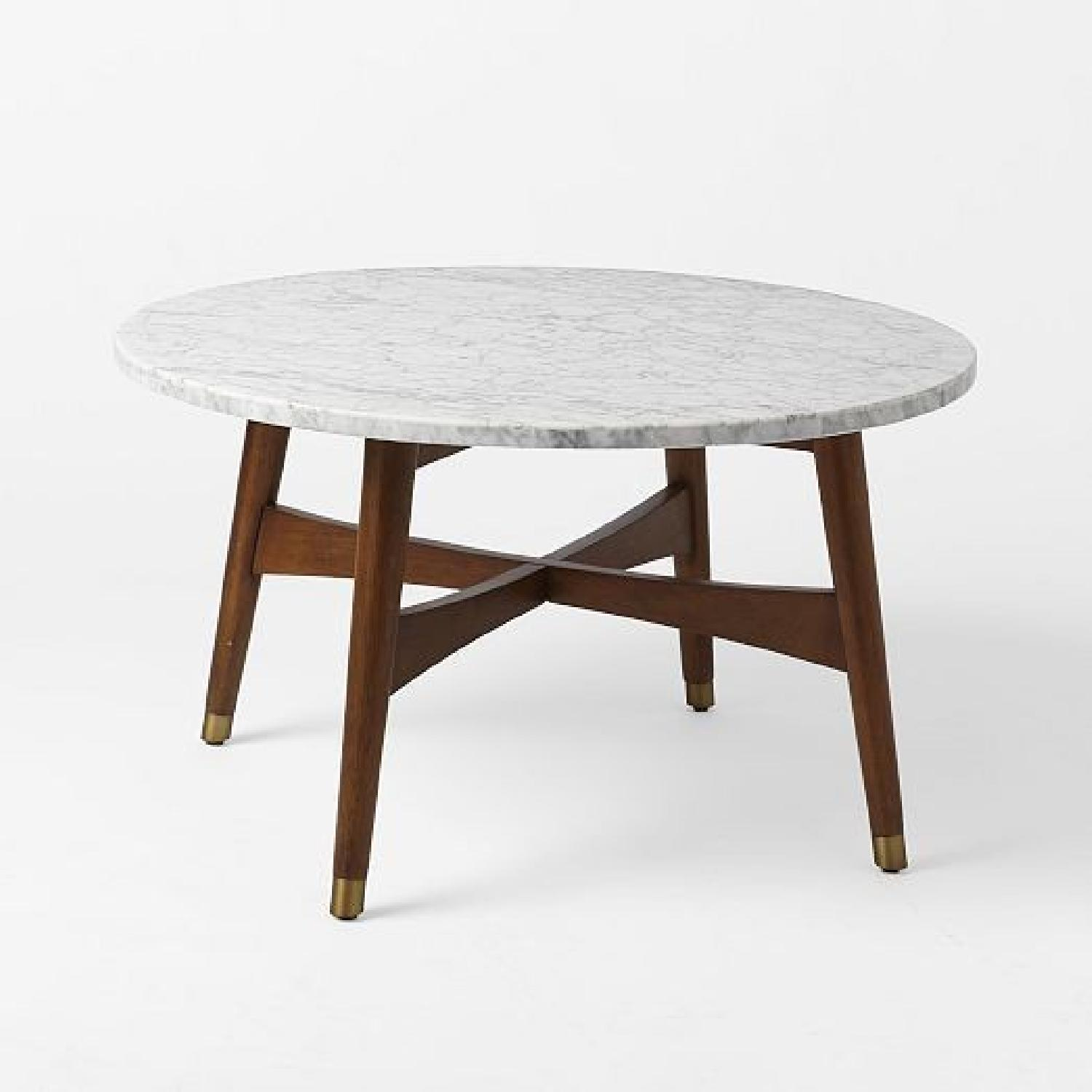 West elm reeve mid century round marblewalnut coffee aptdeco west elm reeve mid century round marblewalnut coffee table geotapseo Gallery