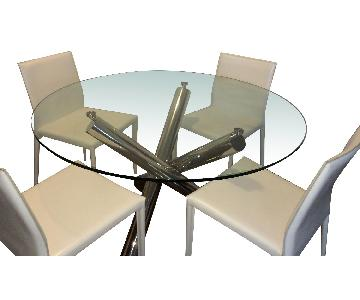 Round Glass Stainless Steel Table w/ 4 White Leather Chairs.
