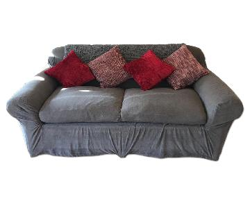 Grey Slipcovered Sofa