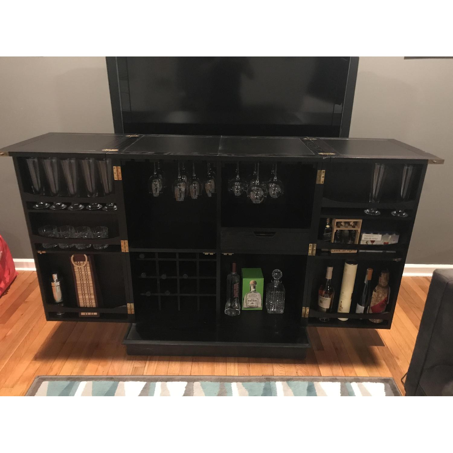 Crate barrel steamer bar cabinet aptdeco for Kitchen cabinets lowes with crate and barrel wall art sale