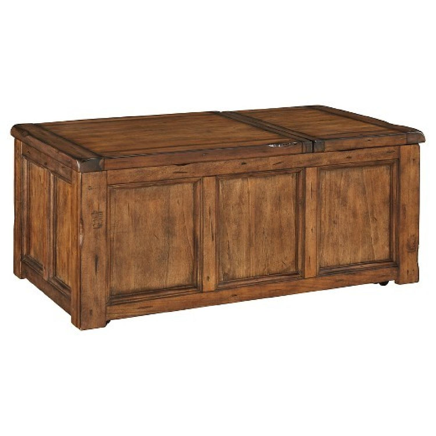Ashley Furniture Tamonie Brown Lift Top Cocktail Table AptDeco