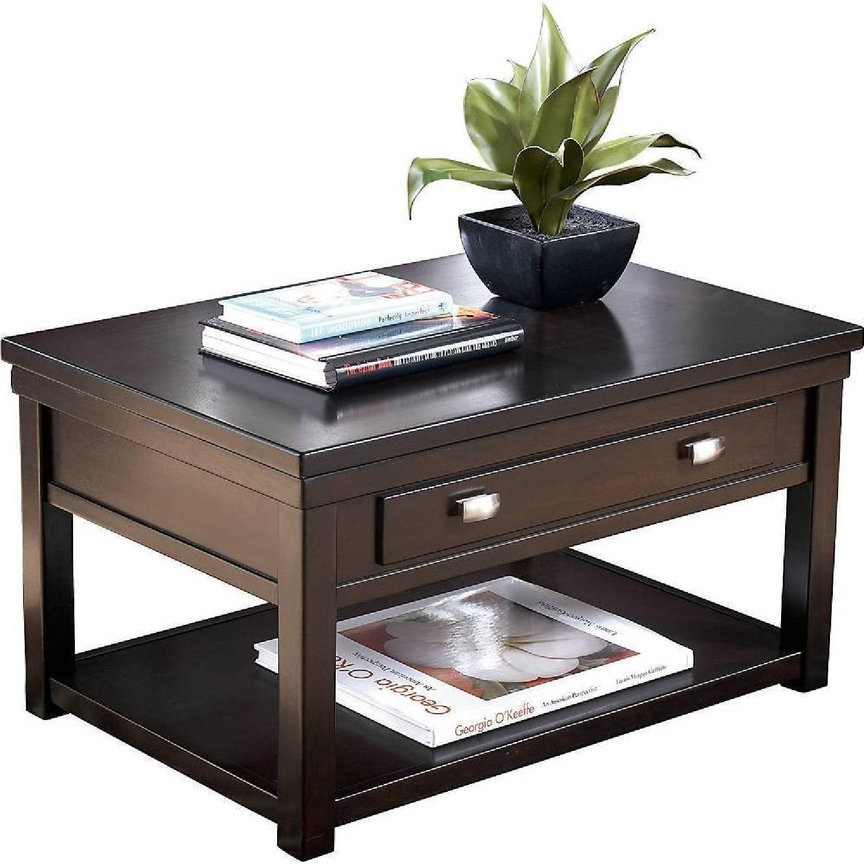 Ashley Furniture Hatsuko Dark Brown Lift Top Cocktail AptDeco
