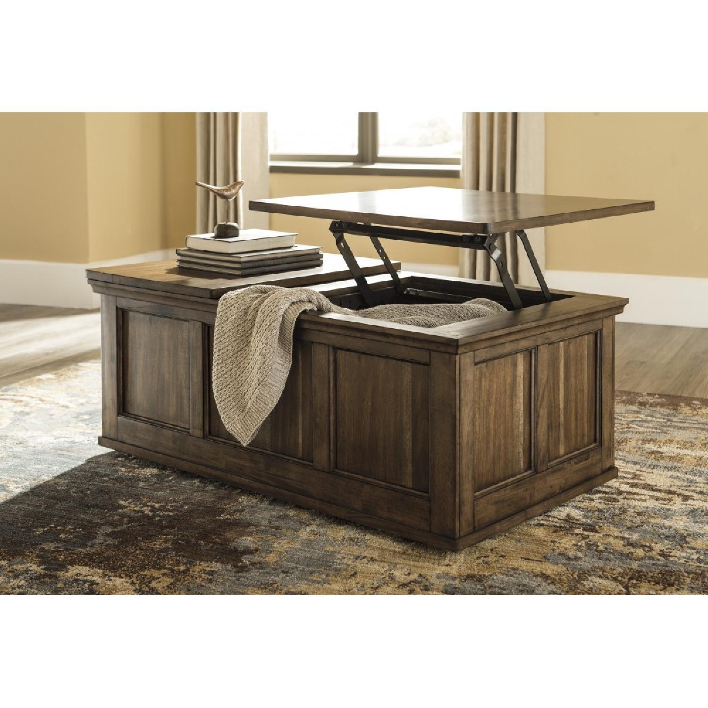 Ashley Furniture Flynnter Medium Brown Lift Top Coffee AptDeco