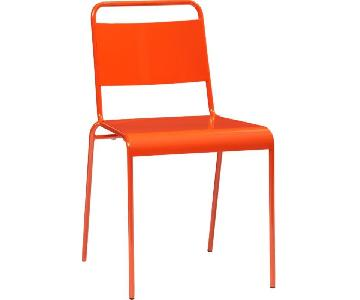 CB2 Lucinda Stacking Orange Dining Chair