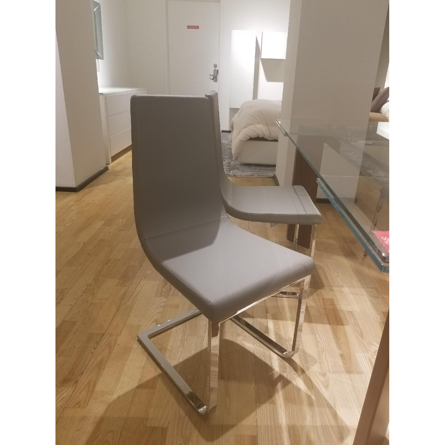 calligaris cruiser dining chair in taupe leather aptdeco
