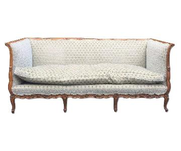 Antique Wooden-Rimmed Couch