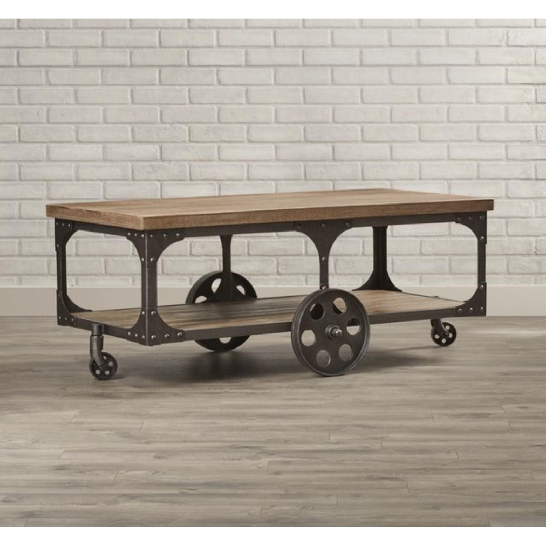 - Coaster Iron Rolling Coffee Table - AptDeco