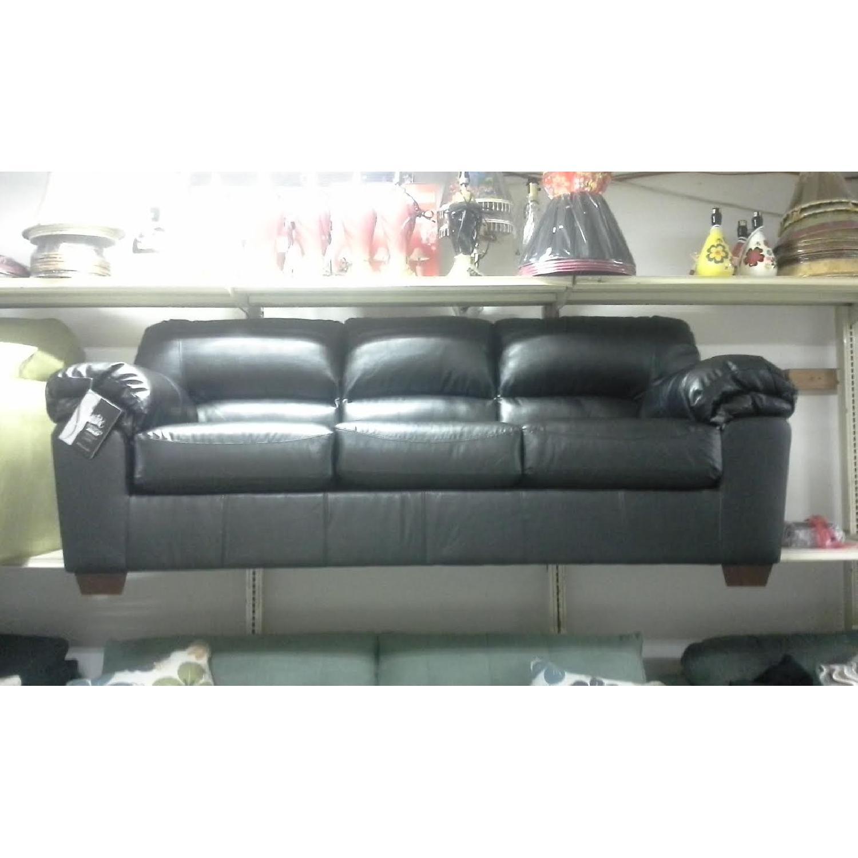 Ashley's Commando Sofa - image-1