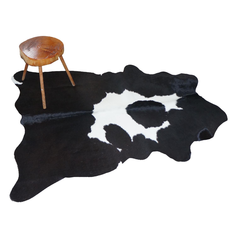 Pristine White on Black Cowhide Rug - image-1