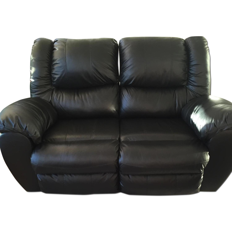 Ashley's Black Leather Recliner Loveseat - image-0