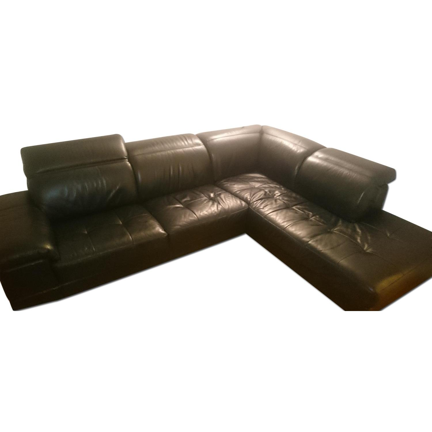 J&M Furniture Black Italian Leather Sectional Couch - image-0