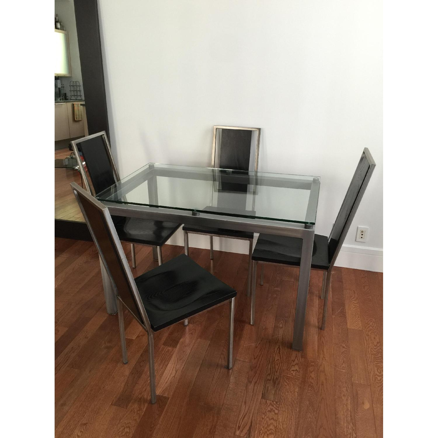 Glass Top/Stainless Base Parsons Table w/ 4 Black Ash Wood Chairs - image-1