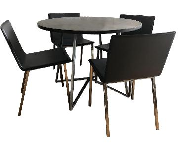 CB2 Peak Round Dining Table w/ 4 Phoenix Carbon Chairs