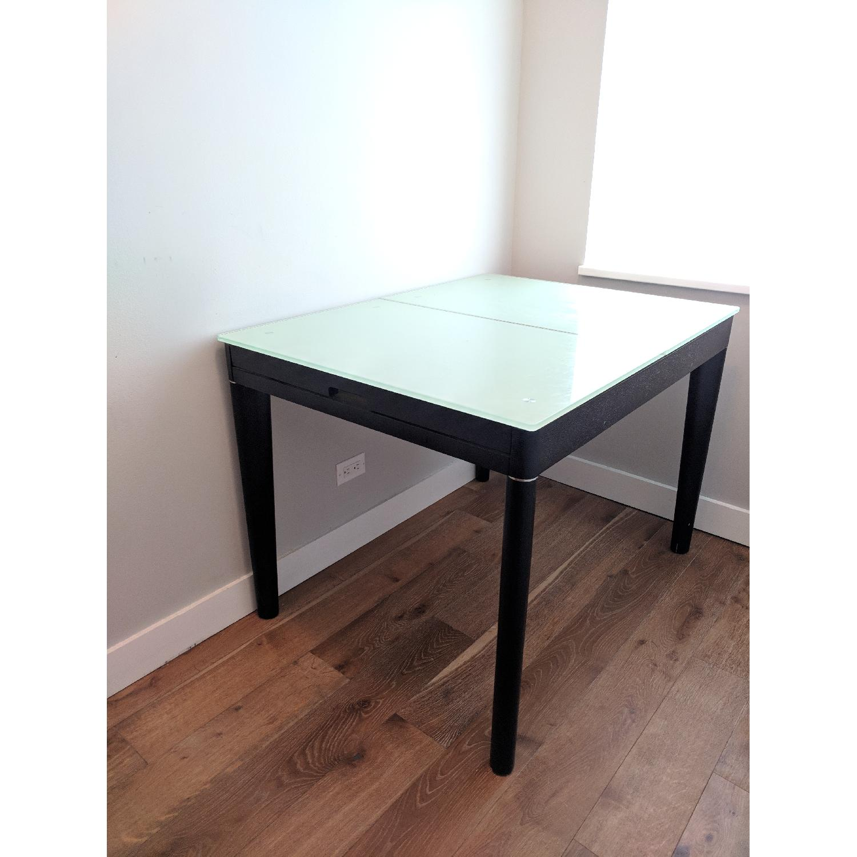 At Home USA Glass & Black Wood Extendable Dining Table - AptDeco