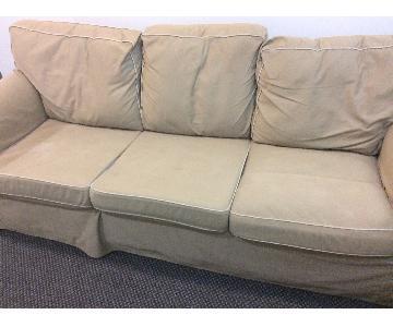 Beige Slipcovered Sofa