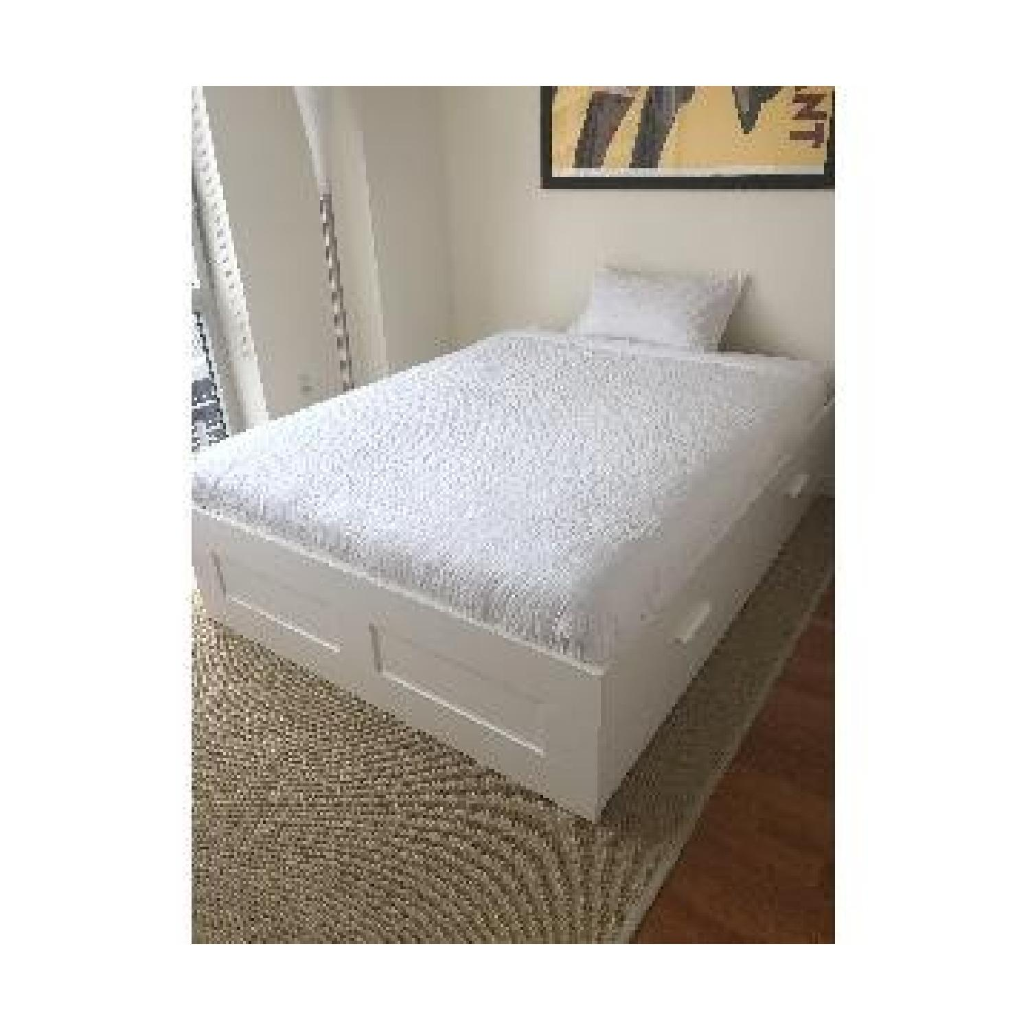 Picture of: Ikea Brimnes White Queen Bed W Drawers Aptdeco