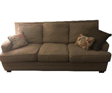 Ashley Beige Fabric Sofa w/ Nailhead Trim