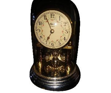 Hermes Quartz Clock w/ Rotating Pendulum