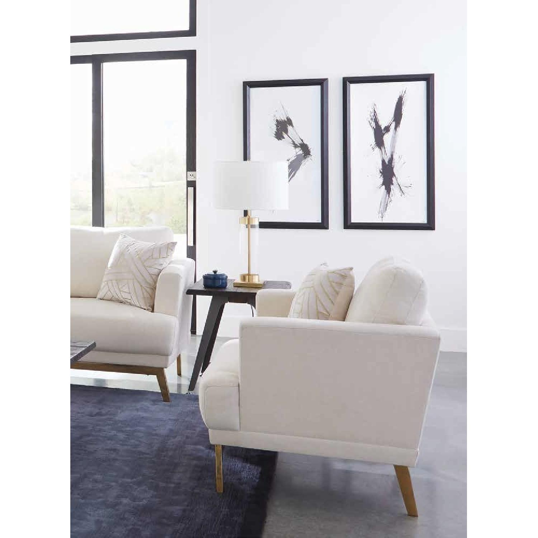Arm Chair in Beige Fabric w/ Flair Arms & Brass Legs