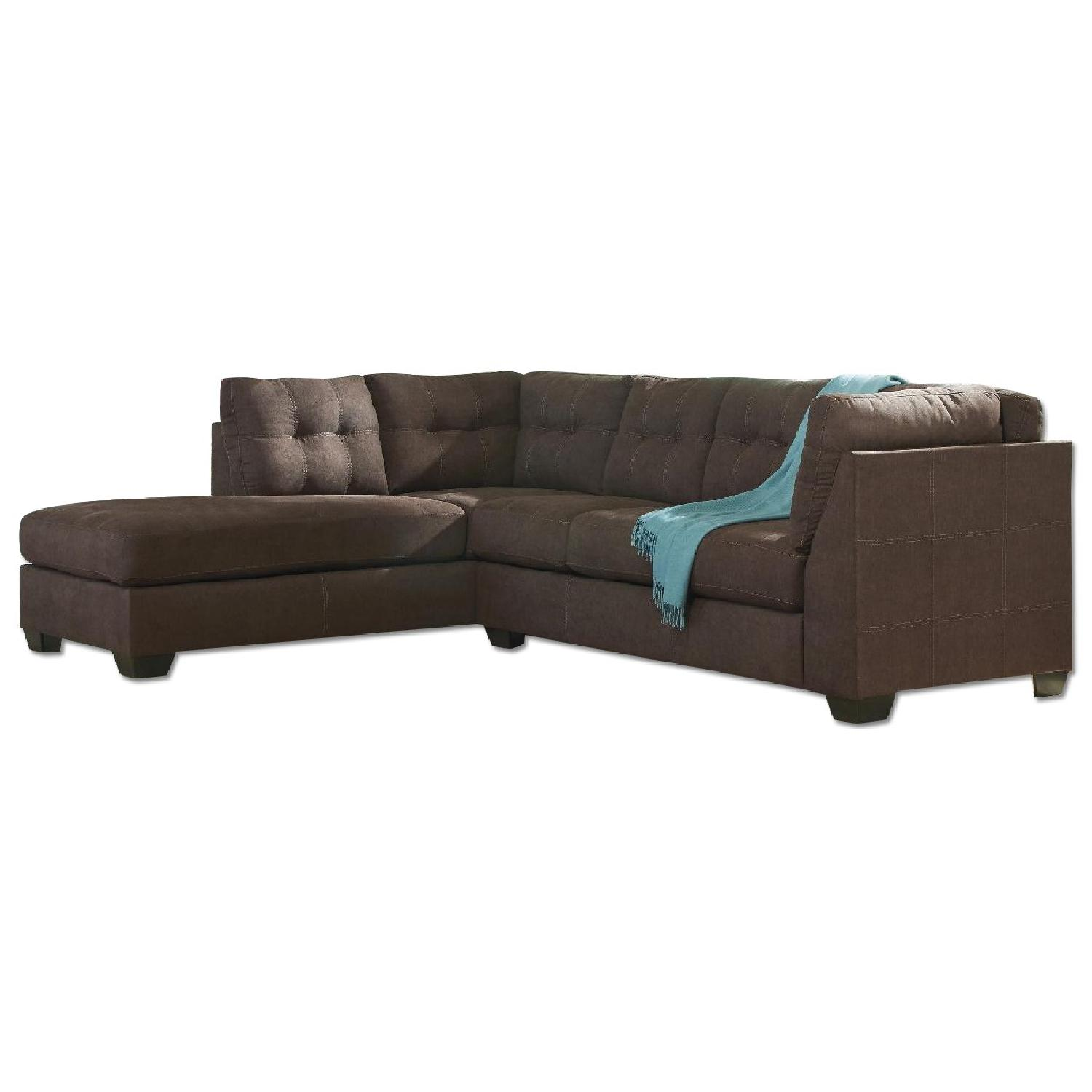 Leather sofa w chaise aptdeco for Ashley leather sectional with chaise