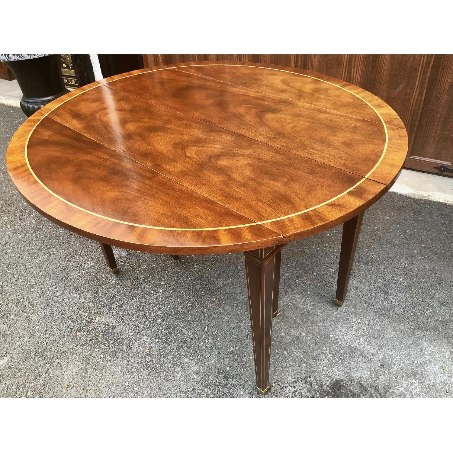 Baker Furniture Regency Style Dining Table on Casters