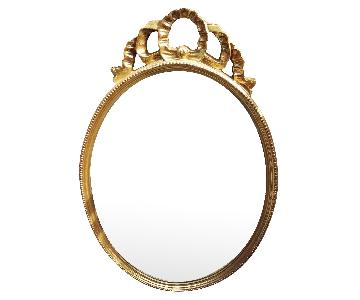 Uttermost Company Oval Gesso Gold Ribbon Top Hall Mirror