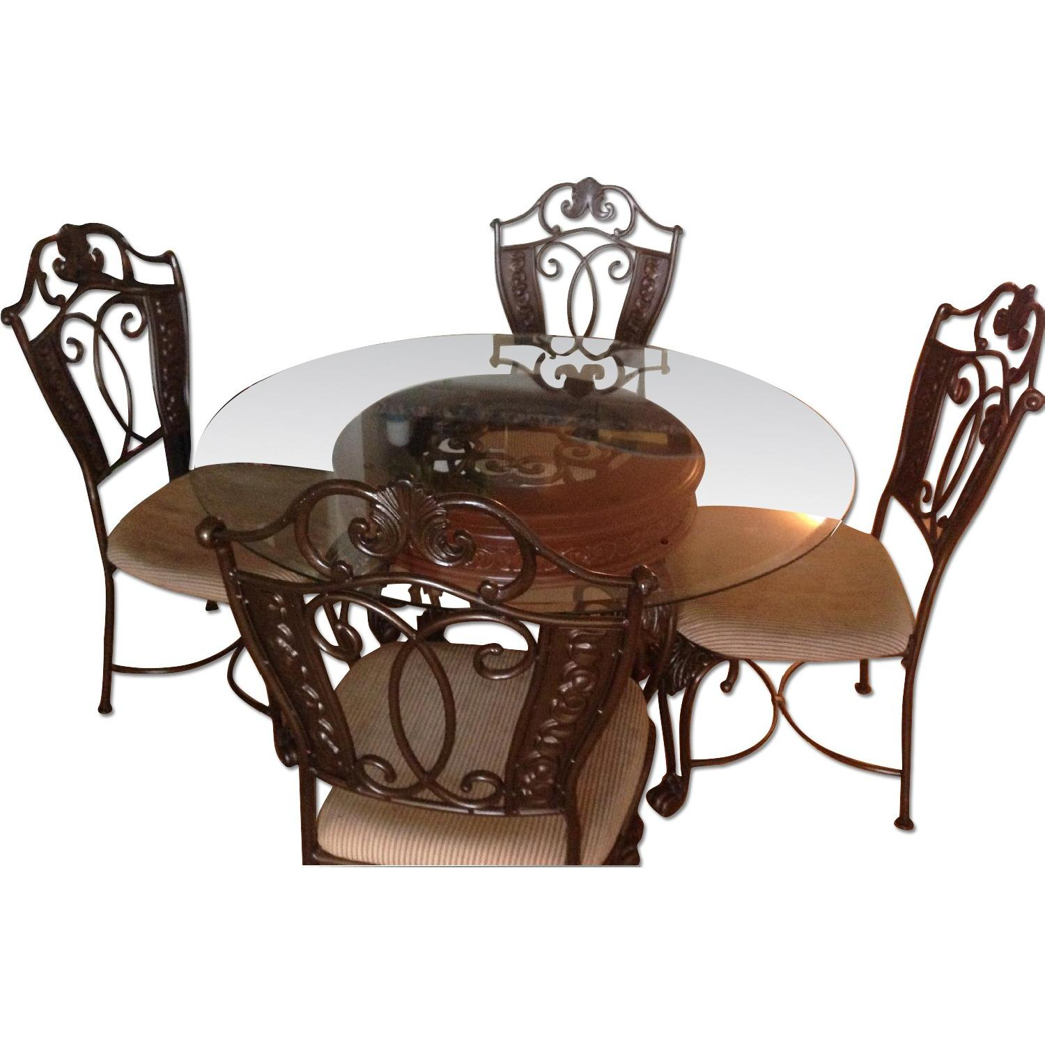 Ashley S Round Glass Top Dining Table W 4 Chairs Aptdeco