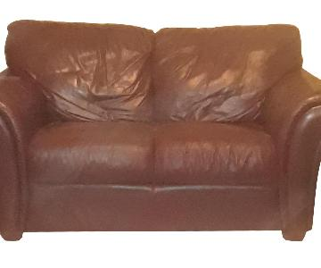 Raymour & Flanigan Burgundy Leather Loveseat