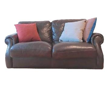 Loveseat in Burgundy Leather w/ Rolled Arms
