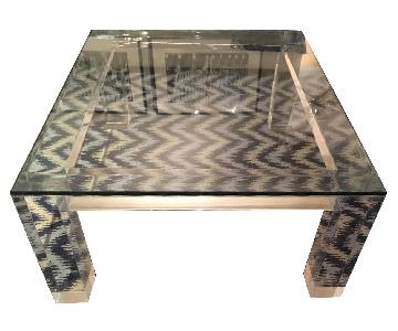 ABC Carpet and Home Glass Top Lacquer Legs Coffee Table