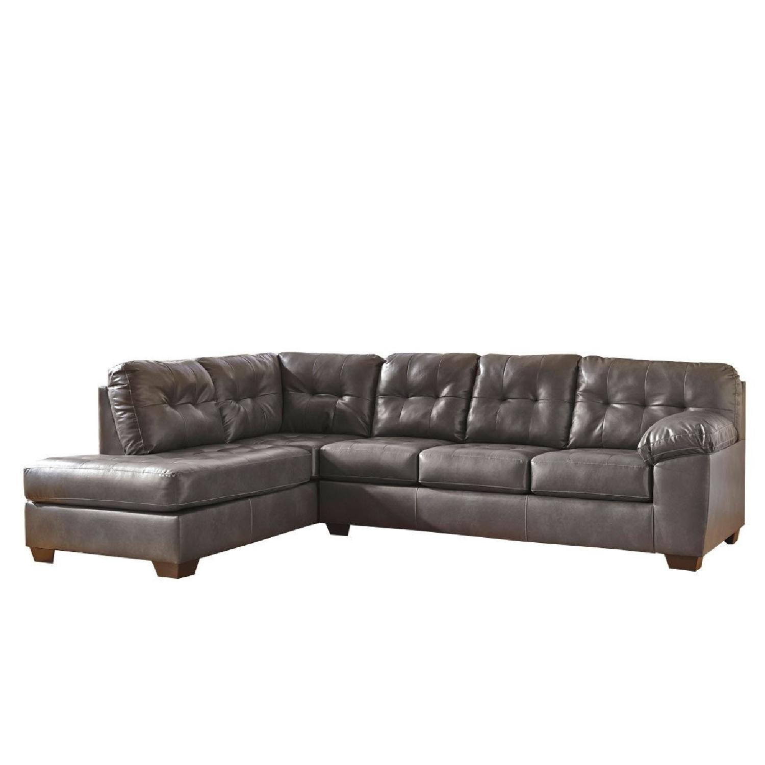 Jennifer Convertibles Grey Tufted Leather Sectional Sofa