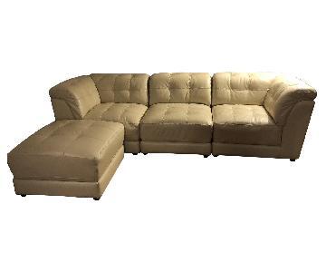 Raymour & Flanigan Cream Leather Sectional Sofa & Ottoman
