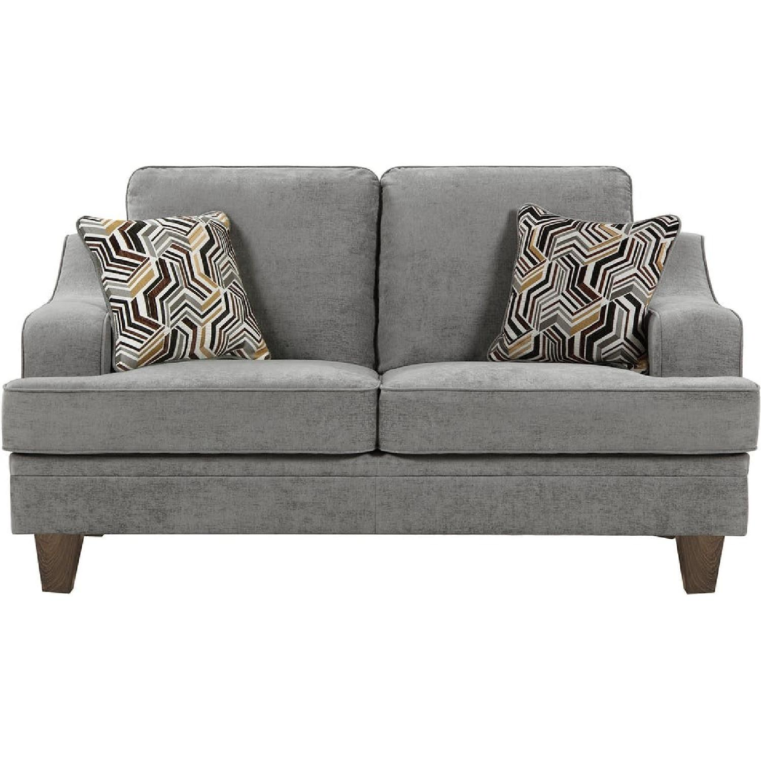 Loveseat in Grey Fabric w/ Sloped Arms