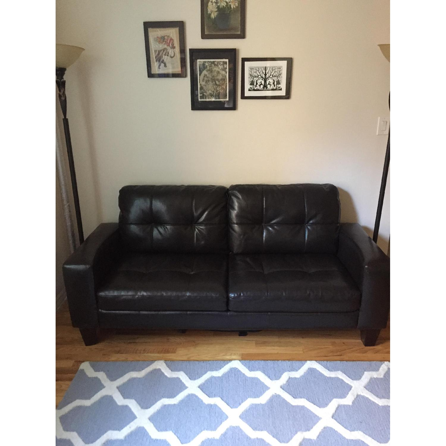 Jennifer Convertibles Black Leather Sofa - image-1