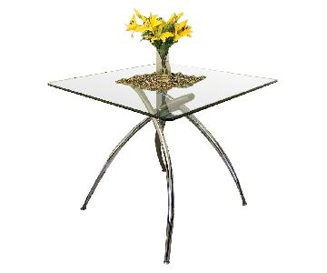 Raymour & Flanigan Glass & Chrome Dining Table