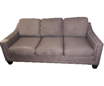 Bob's Beige Studded Sofa