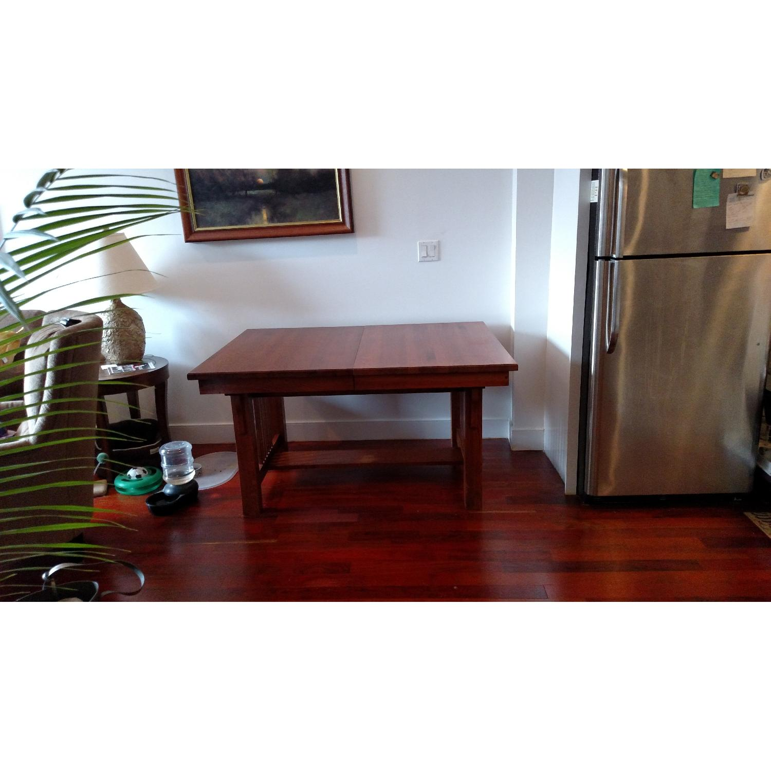 Solid Oak Mission Style Dining Table w/ 2 Self-Raising Leaves - image-1