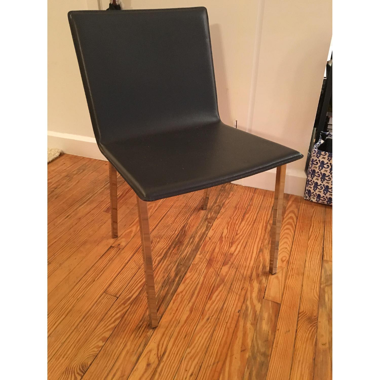 CB2 Dark Blue Leather Chairs w/ Chrome Metal Legs - image-1