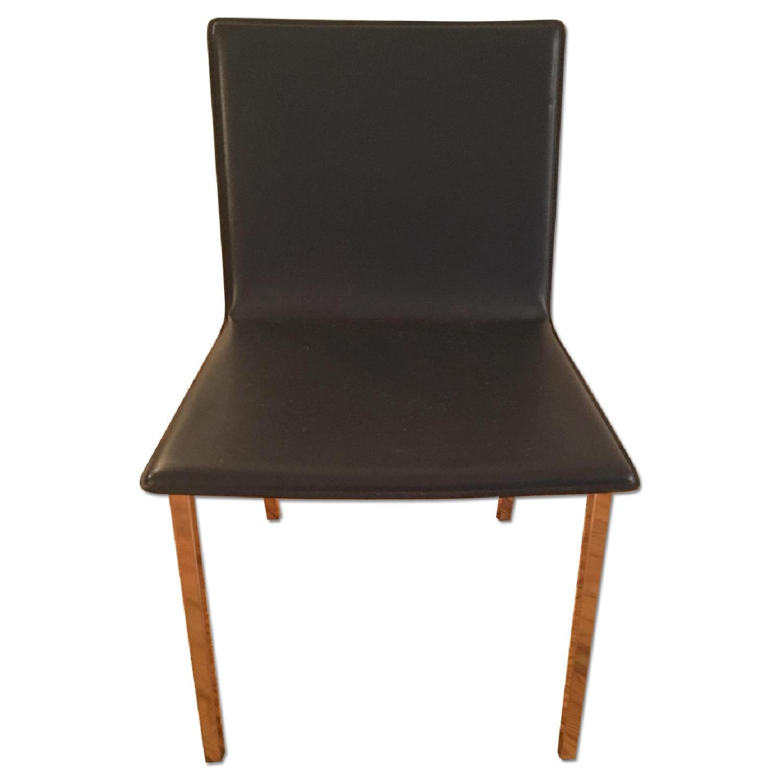 CB2 Dark Blue Leather Chairs w/ Chrome Metal Legs - image-0