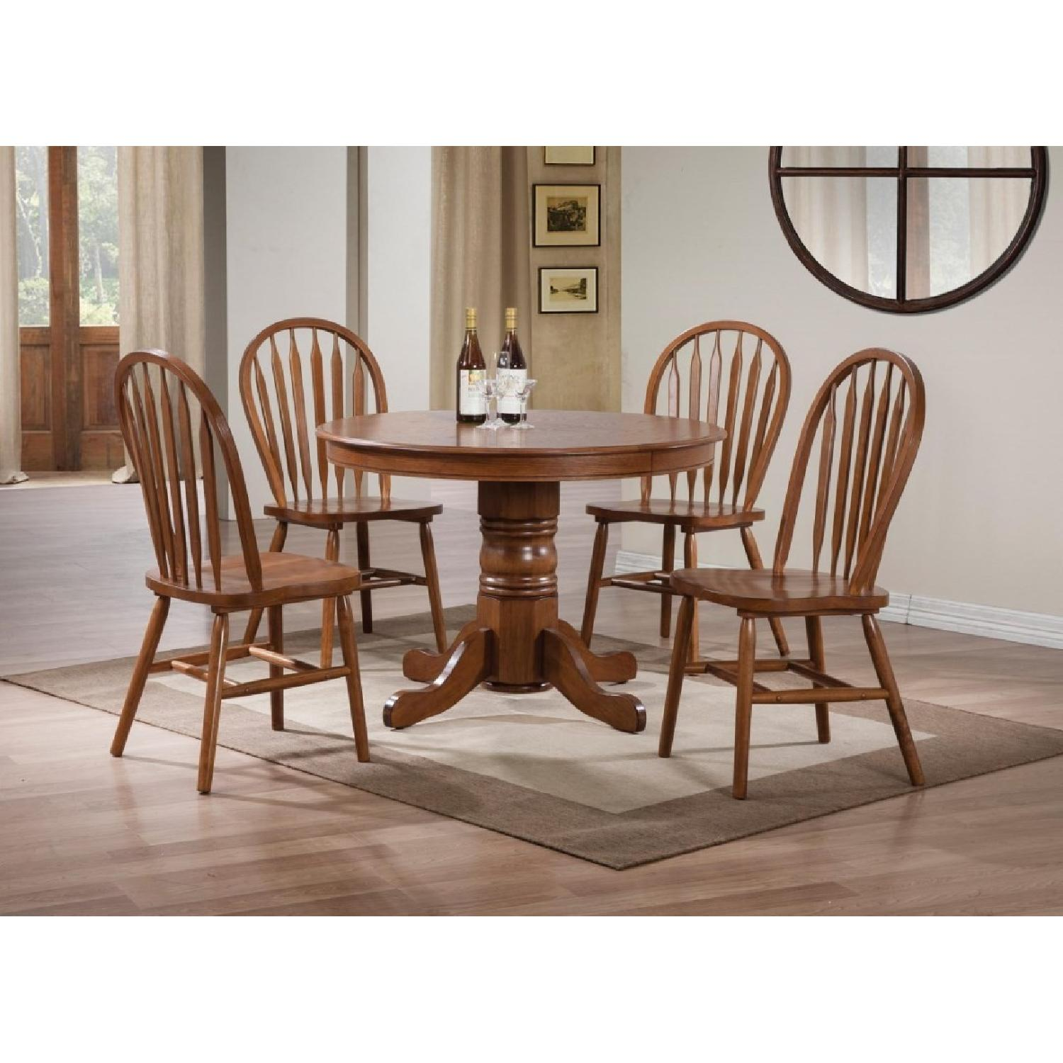 Country Style Round Pedestal Dining Table in Warm Oak Finish - image-1